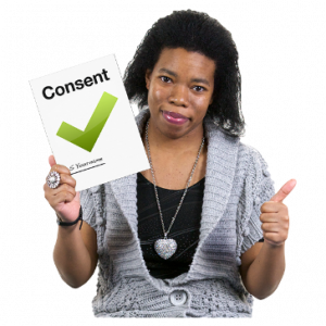 A photo of a woman giving a thumbs up. She is holding a consent form.