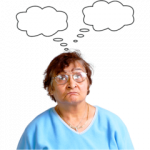 A photo of a woman thinking. There are thought bubbles above her head.