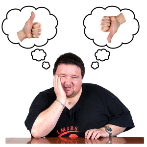 A photo of a man sat down. He looks deep in thought. He has two thought bubbles above his head. One thought bubble has a thumbs up. The other thought bubble has a thumbs down.